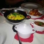 Spanish stew of chorizo, chicken and pork in Rioja, Paella and Patatas Bravas