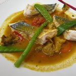 Steamed fish with vegetables in a thai style stock