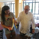 Koby, the owner, teaches Ofek, my daughter, how to prepare pasta.