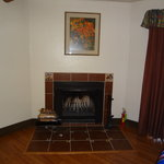 Lovely Fireplace with Logs Furnished