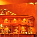 Curved wood bar and fireplace