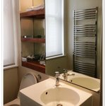 Bathroom with heated towel rail bar