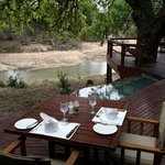 Enjoy a drink on the deck outside while watching bushbuck grazing.