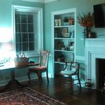 Living/dining room with dining table set for breakfast