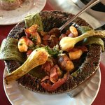 Bacon-wrapped shrimp molcajete with roasted cactus
