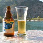 Having a beer on the jetty watching the river and rock tombs