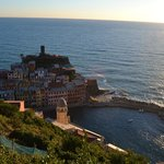 View of vernazza from the hilltops. (hotel is to the left of the tower, pink bldg)