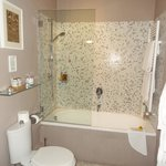 Bath/shower with Moulton Brown products on pump