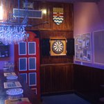 The Dart Board and False Telephone Box leading to the toilets.
