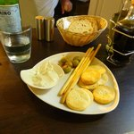A complimentary platter - Heavenly blue cheese dip and stuffed olives with crackers and grissini