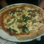 Pizza with turnip greens and sausage