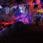 In the cave: Stalactites colourfully lit.