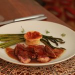 Roasted duck, souffle, and asparagus