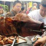 pig roasting at fair