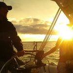 Enjoying the sunset while sailing with Capt. Brad.