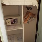 closet with hangers and a safe