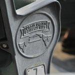 Cast insignia on stadium seat.