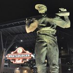 Night view: statue outside Whataburger Field.