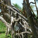 Statue hidden in the tree