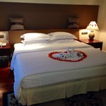 Our beautifully decorated bed with rose petals and turtle doves on our anniversary!