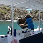 Cooking lunch for us on the boat