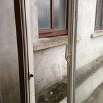Single Glazed windows, crumbling rear facade.