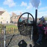 steam engine with Victorian street in background