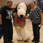 . taking pictures with a Knotts Berry Farm host Snoopy