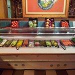 Salad toppings bar.