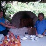 Elly translating in English Dona Alijandra's baking techniques
