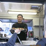 Sarb ,manager of Soho,delicious butter chicken on homemade naan.
