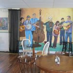 Mural, piano and artwork add to the environment