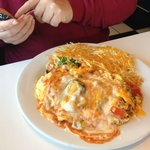 Bob calculating the time to eat this - the Big Kahuna Omelet. It got 5 stars from him!!