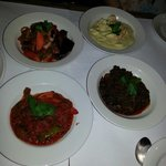 Beef stew. Chicken curry. Goat dish and vegetable dish