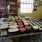 A community works program creating beautiful pottery.