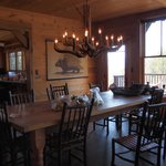 dining area with rustic table and chandelier