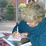 Peggy Perry signing her book of poems
