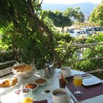 Eating breakfast on front veranda of hotel