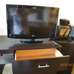 Tv on dresser with roomy drawers