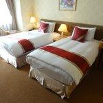 コスモスホテル(天成大飯店)ベッドルーム