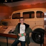 Griffin in front of the bullet riddled car of Bonnie and Clyde.