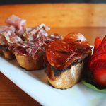 The cured bruschetta app. Fresh wood fired bruschetta topped in cured meats like salumi, peppero
