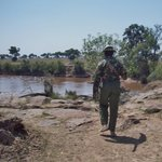 Escorted to a watering hole of hippos while on a walking safari