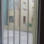 Кусок крыши, двор и окна