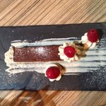Chocolate cake with truffle cream and raspberries on the side!!