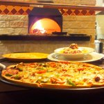 Firebaked pizza and pasta entrees in our wonderful wood burning oven