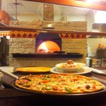 Pizza and Pasta Entrees baked to perfection in our wood fired oven