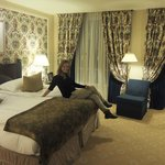 The young lady enjoying the spacious and stylish room!
