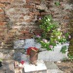 Small shrine near garden wall