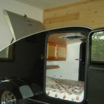 Inside Harley themed suite. Camper inside of the bedroom.